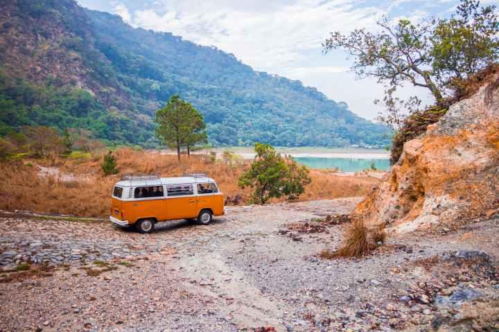 photo of volkswagen kombi on unpaved road